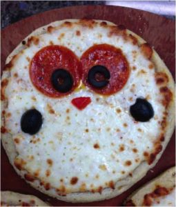 pizza toppings decorated like owl