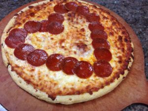 pepperonis forming a shape of a heart on a pizza