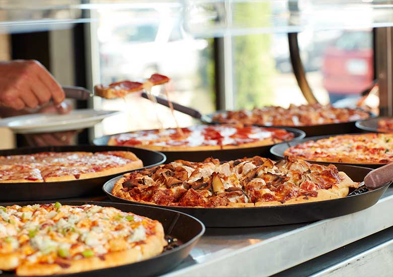 lunch buffet pizzas with multiple toppings