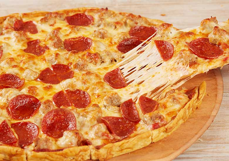 Cheesy Pepperoni Pizza with a Slice being Pulled out