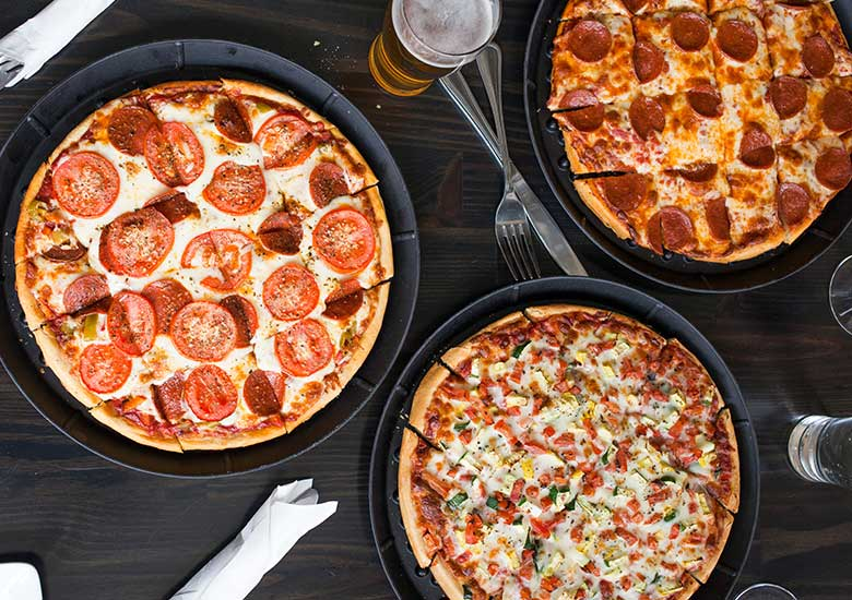 Assortment of Home Run Inn Pizzas on a table