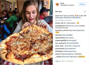instagram post of girl eating pizza