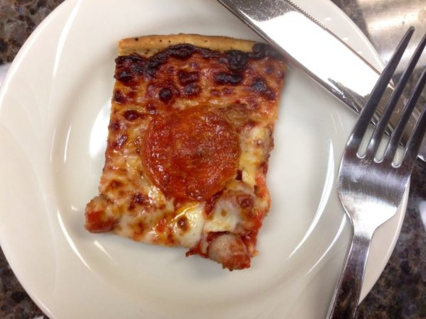 square slice of pepperoni and sausage pizza