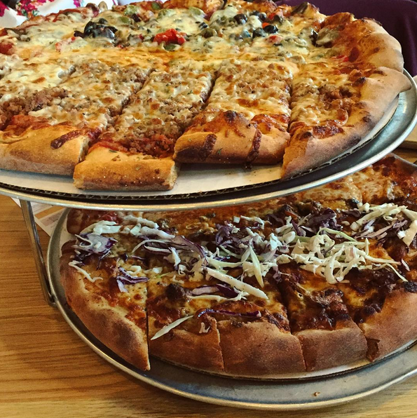 pizzas elevated on top of each other