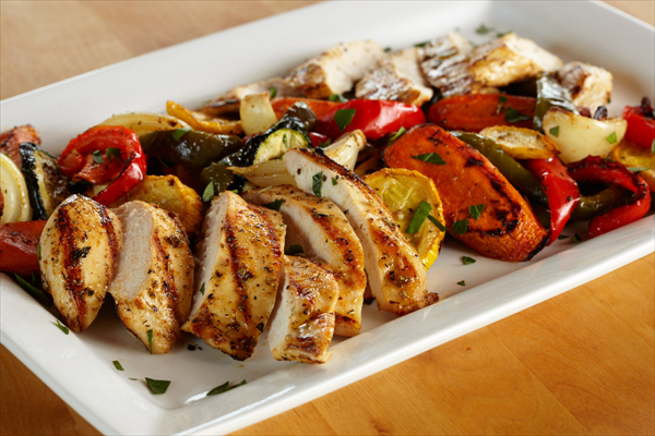 chicken and roasted vegetables on a plate