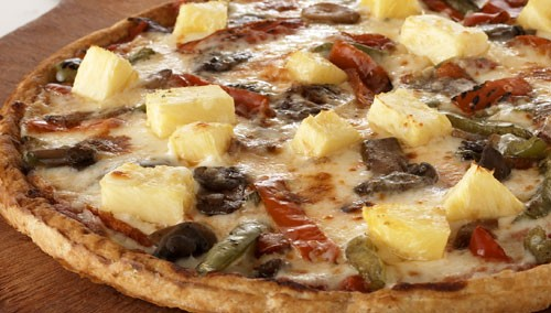pineapple pizza with red peppers, mushroom, and green peppers