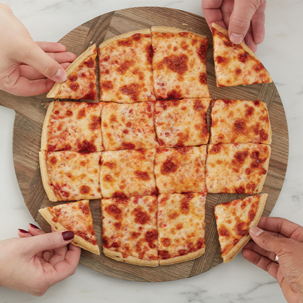 cheese pizza cut into squares four hands coming in to grab corner slices