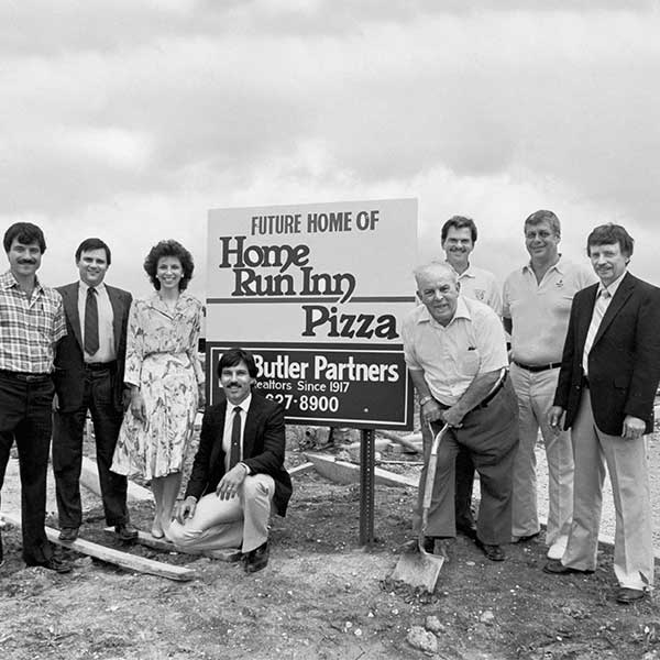 Vintage Black an White Picture of Home Run Inn Family standing on the site of Woodridge Plant before it was built