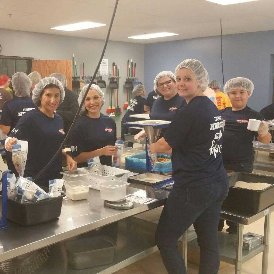 Home Run Inn employees volunteering at Feed my Starving Children