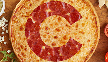 pepperoni topped on pizza in the shape of chicago cubs logo