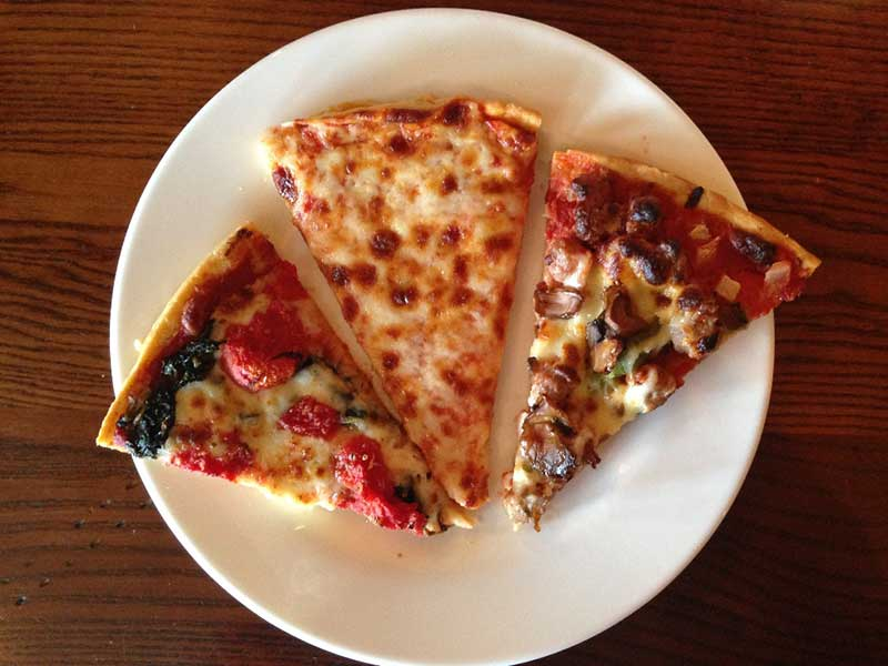 triangle slice of laura's favorite, cheese, and nick's supper pizza
