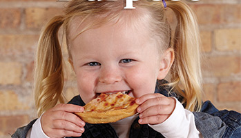 toddler girl eating a slice of pizza