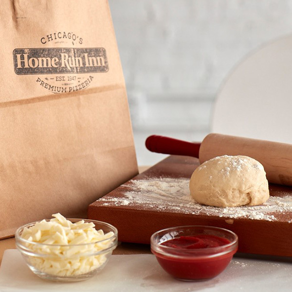 Pizza Dough sauce cheese and brown bag from DIY Pizza Kit