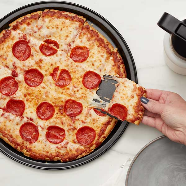 slice of pepperoni pizza being pulled